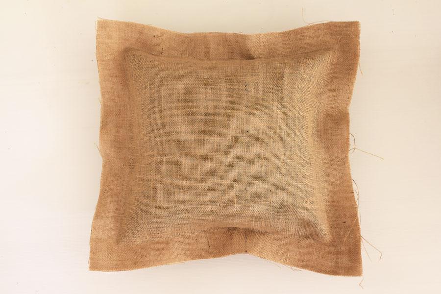 Burlap cushion with raw hem, before making fringe