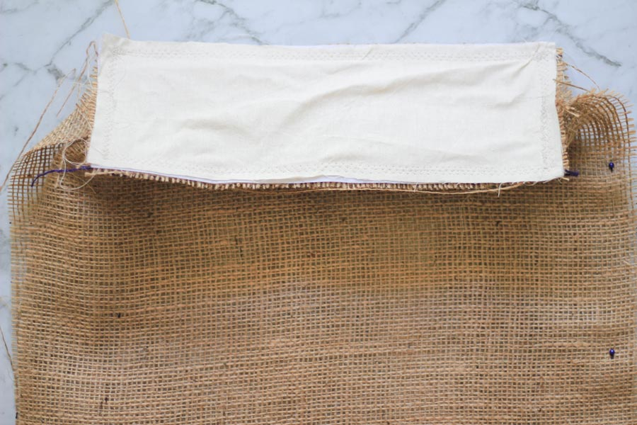Pinning and sewing the base of the burlap tote to the sides | Dossier Blog
