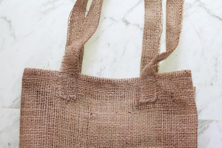 Pin and sew the straps in place on your burlap tote | Dossier Blog