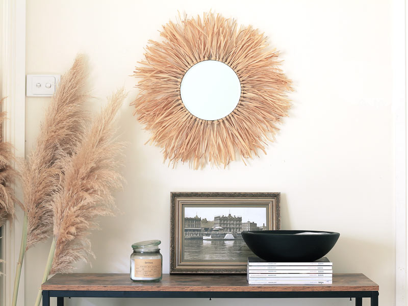 Raffia sunburst Mirror DIY. Pump up the neutrals and naturals in your home with this round juju inspired mirror