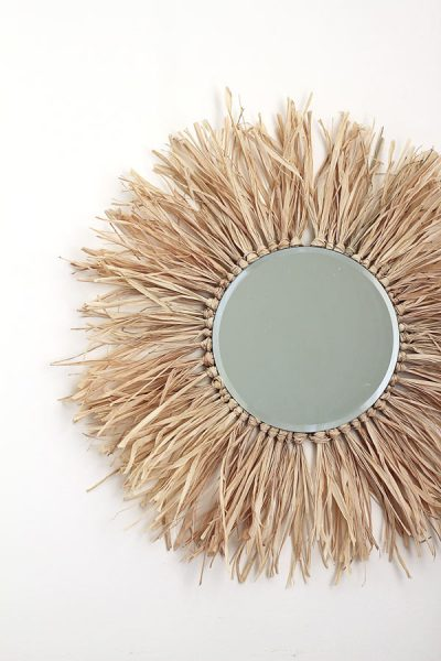 How to make this raffia-fringe round mirror, a take on the ever-popular sunburst mirror trend! It also gives an African juju hat vibe