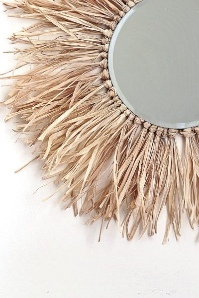 Create this round raffia sunburst mirror yourself and bring those boho, island vibes into your home!