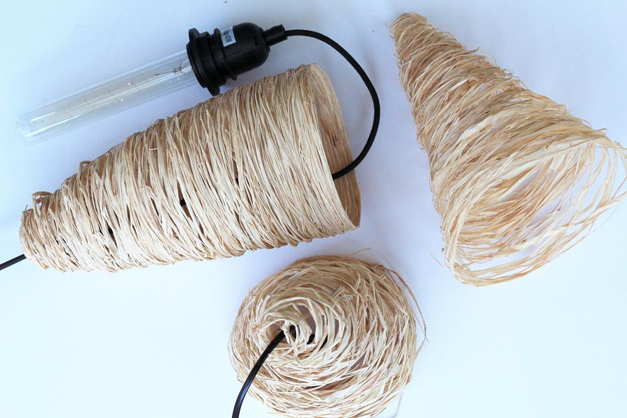 Thread a light fixture through your DIY raffia pendant to complete the look | Dossier Blog